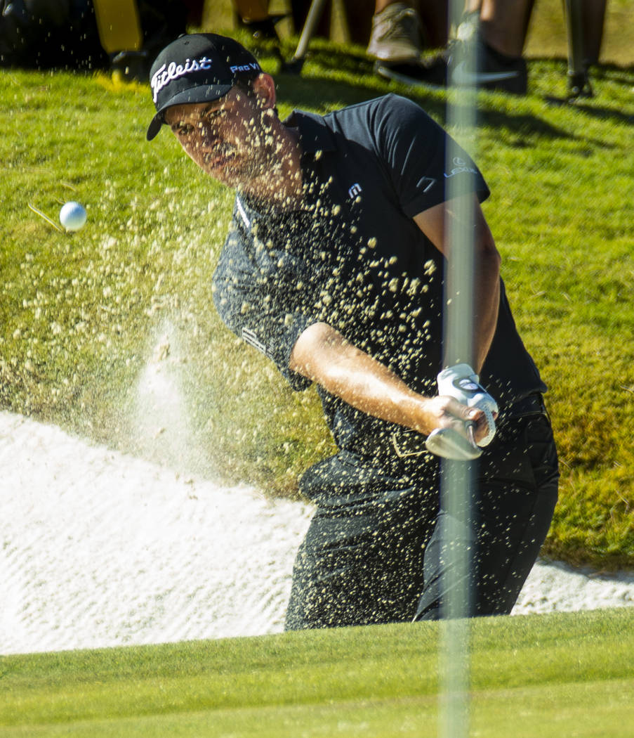 Patrick Cantlay blasts out of the sand onto the green at hole 9 during the final round of Shrin ...