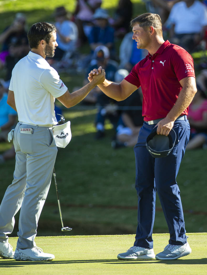 Adam Hadwin , left, and Bryson DeChambeau shake after finishing hole 18 during the final round ...