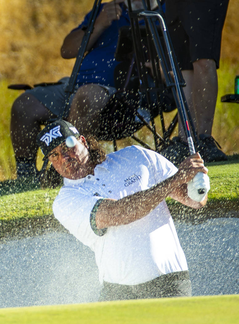 Pat Perez blasts from the bunker and onto the green at hole 15 during the final round of Shrine ...