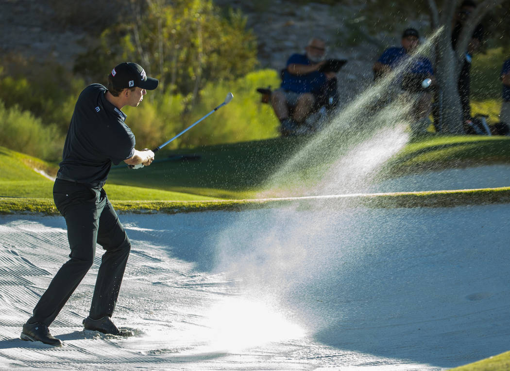 Patrick Cantlay blasts out of the sand onto the green at hole 15 during the final round of Shri ...
