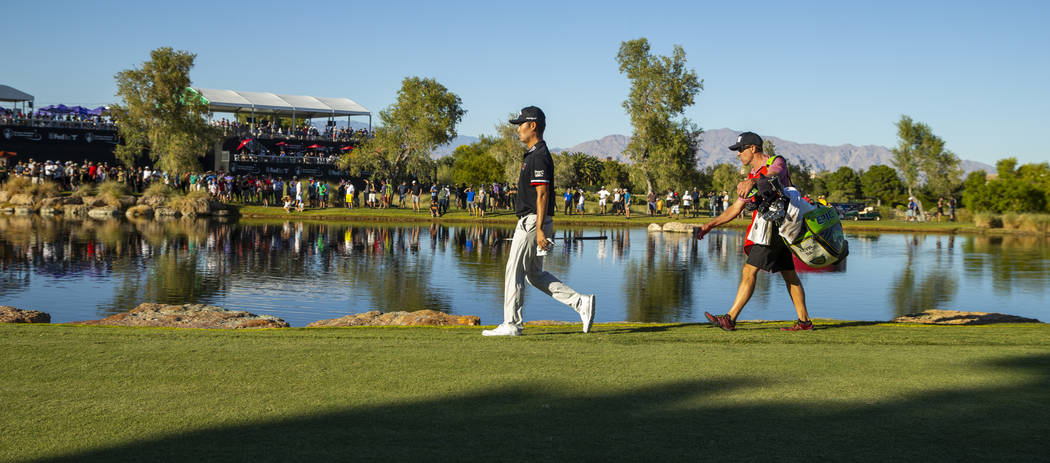 Kevin Na makes his way up to the green at hole 16 during the final round of Shriners Hospitals ...