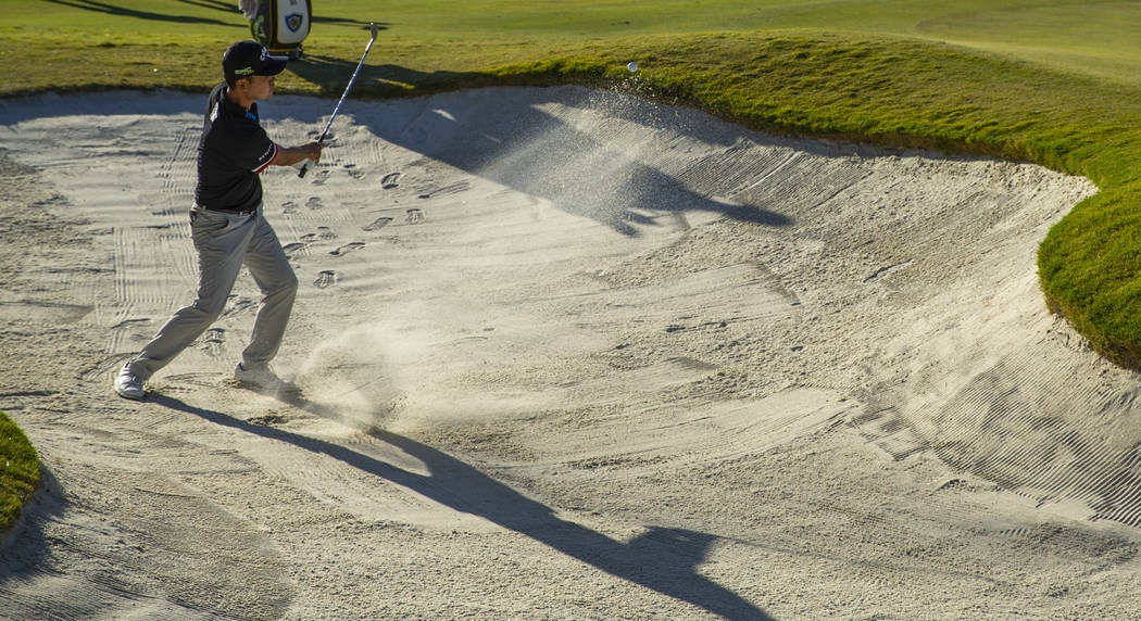 Kevin Na blasts out of the sand onto the green at hole 16 during the final round of Shriners Ho ...
