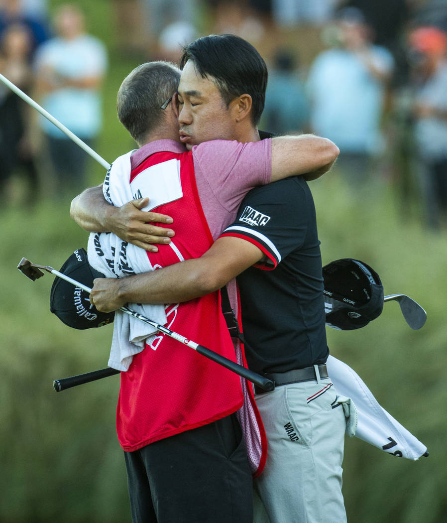 Kevin Na hugs his caddie as he celebrates his victory on the second playoff hole at 18 during t ...