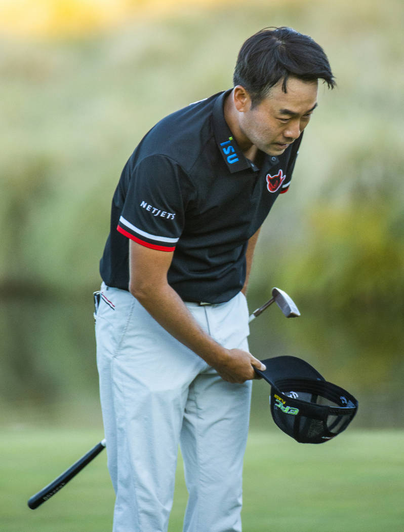 Kevin Na bows to the gallery as he celebrates his victory on the second playoff hole at 18 duri ...