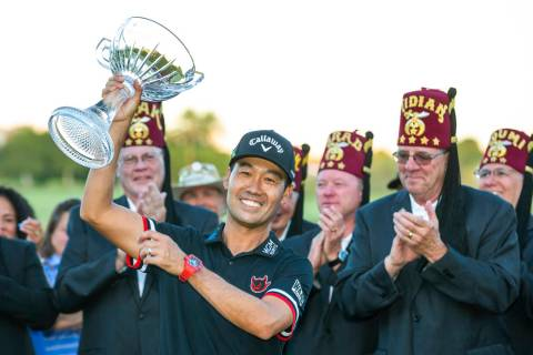 Kevin Na, center, holds up his trophy after winning the tournament at the final round of Shrine ...