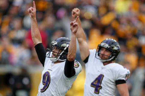Baltimore Ravens kicker Justin Tucker (9) and Sam Koch (4) celebrate after Tucker made a field ...