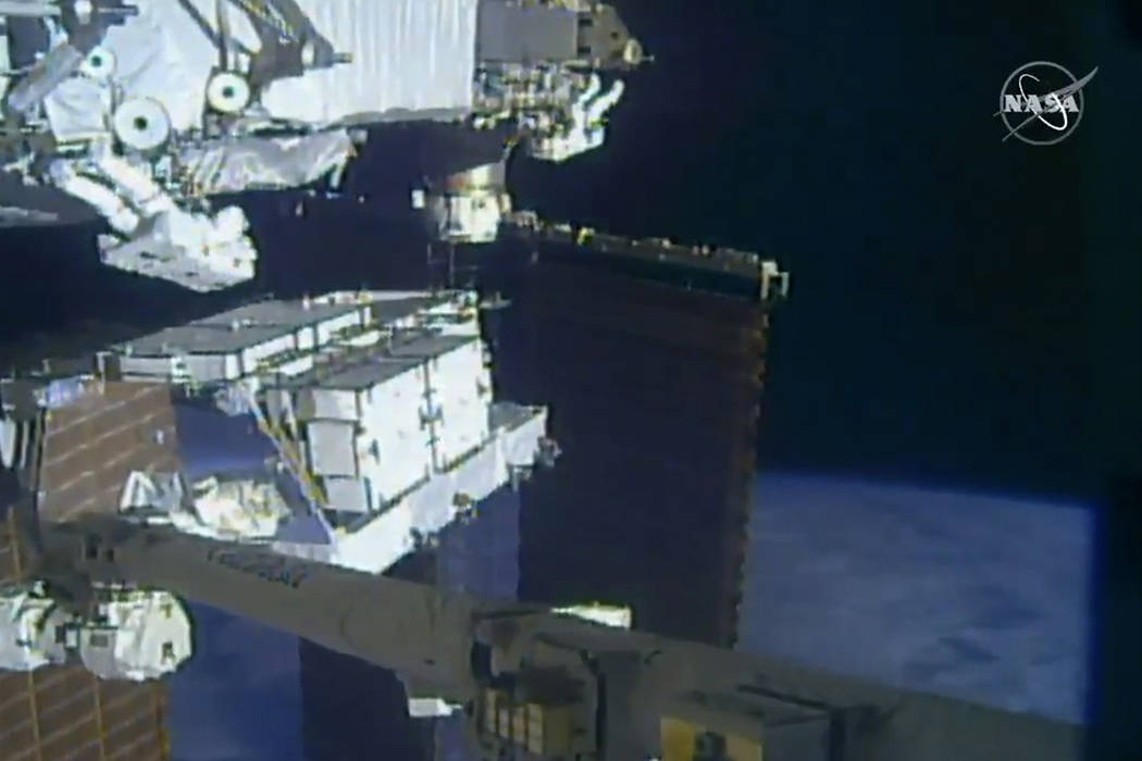 In this image made from video provided by NASA, NASA astronauts Christina Koch and Andrew Morga ...