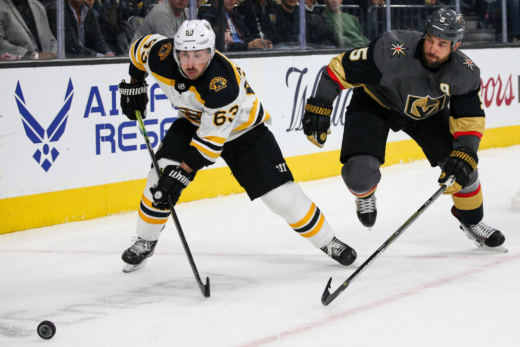 Boston Bruins left wing Brad Marchand (63) skates towards the puck as Vegas Golden Knights defe ...