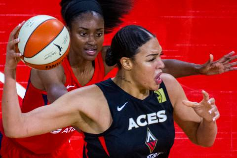 Las Vegas Aces center Liz Cambage (8, front) looks for a pass over Washington Mystics forward L ...