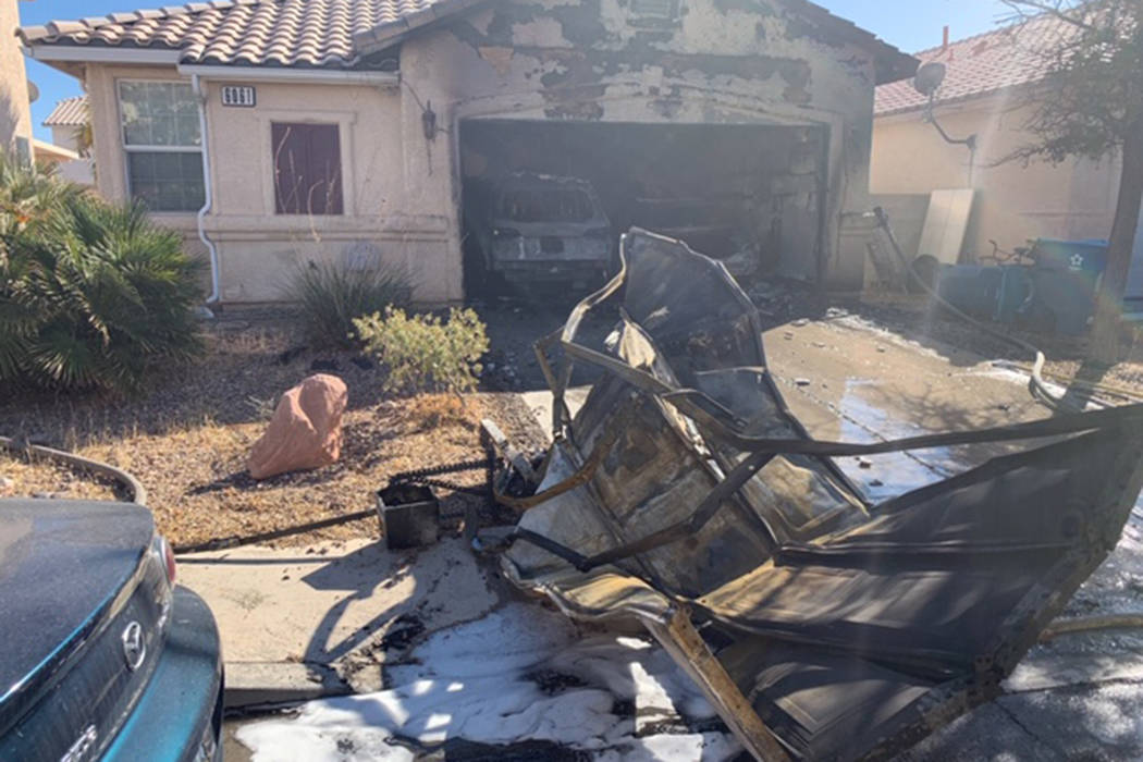 A fire damages a home Sunday, Oct. 6, 2019, on the 6000 block of Dewberry Court in Las Vegas. ( ...