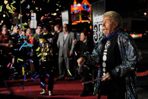 "Comedian Rip Taylor throws confetti on photographers at the premiere of the film ""Jackass ..."