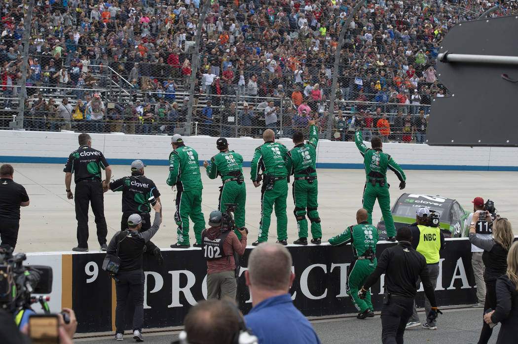 Kyle Larson's team celebrates on pit road after his win in the NASCAR Cup Series playoff auto r ...