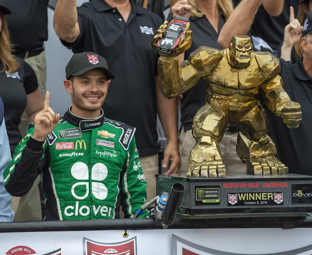 Kyle Larson stands next to the trophy after winning the NASCAR Cup Series auto race Sunday, Oct ...