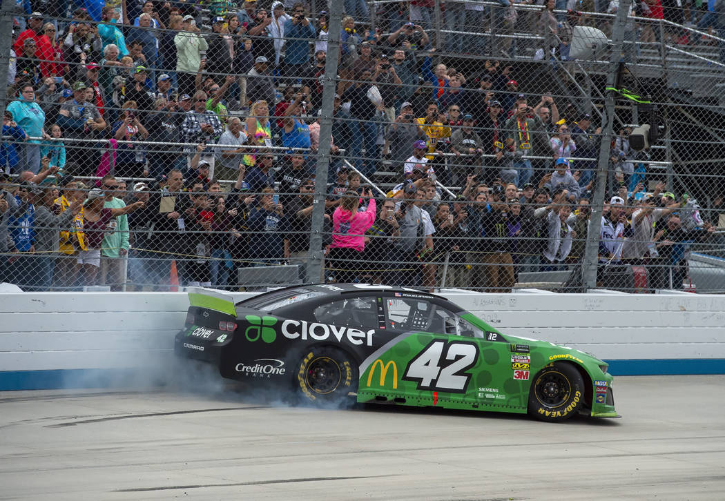 Kyle Larson does a burnout after winning the NASCAR Cup Series playoff auto race Sunday, Oct. 6 ...