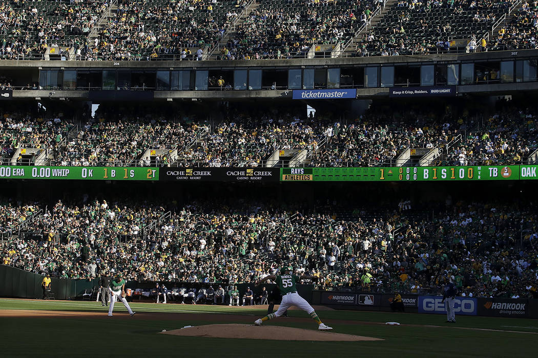 Fans at RingCentral Coliseum watch as Oakland Athletics pitcher Sean Manaea (55) throws to a Ta ...