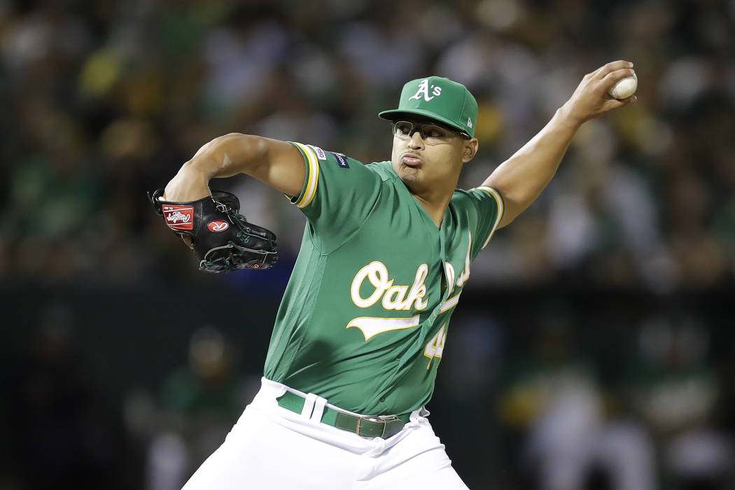 Oakland Athletics pitcher Jesus Luzardo throws to a Tampa Bay Rays batter during the sixth inni ...