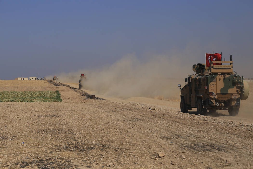 A Turkish n armored vehicles patrol as they conduct a joint ground patrol with American forces ...