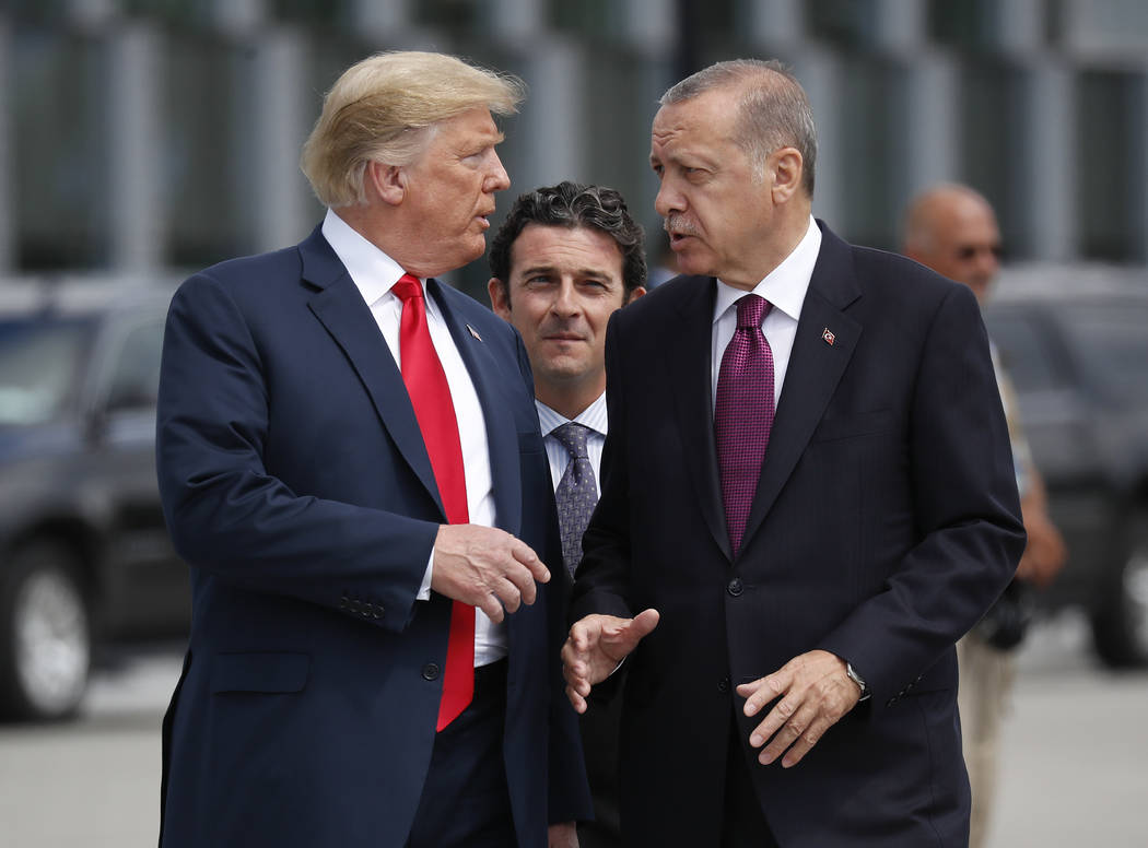 FILE - In this Wednesday, July 11, 2018, file photo, President Donald Trump, left, talks with T ...