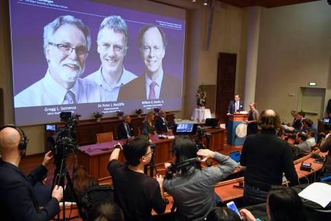 Thomas Perlmann, far right, Secretary-General of the Nobel Committee announces the 2019 Nobel l ...