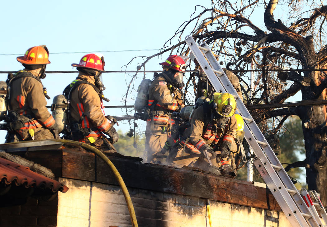 Clark County and Las Vegas firefighters battle a fire in a commercial area at 824 E. Sahara Ave ...