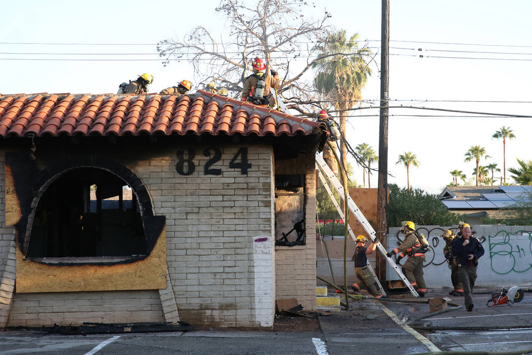 The Clark County and Las Vegas firefighters battle a fire in a commercial area at 824 E. Sahara ...
