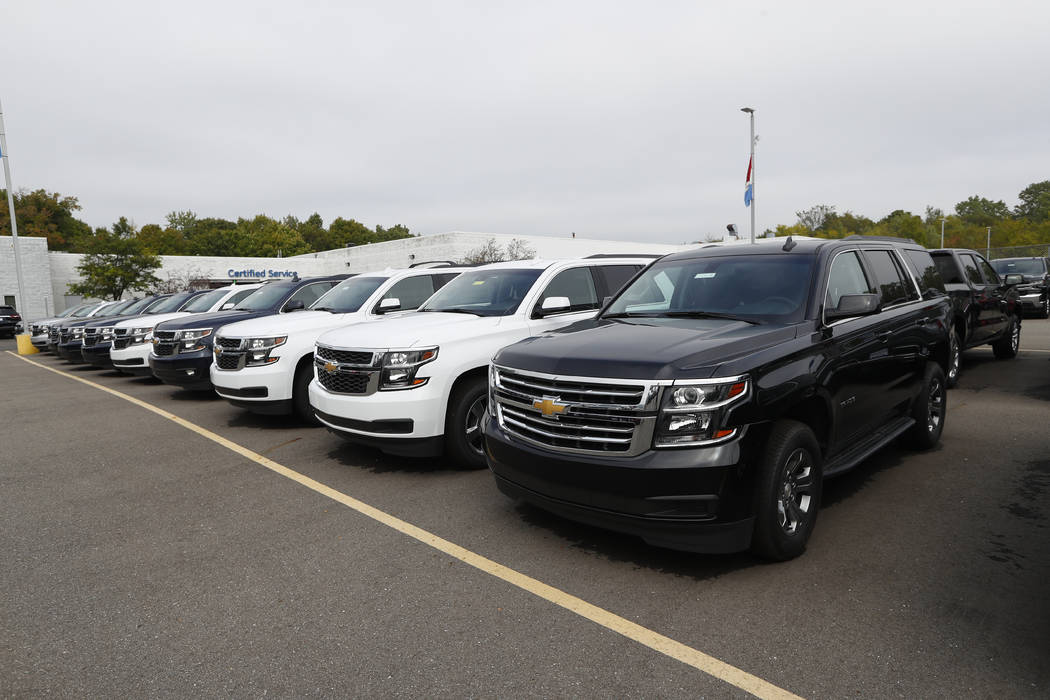 In this Monday, Sept. 30, 2019, photo a row of Chevrolet Suburban vehicles are shown at Wally E ...