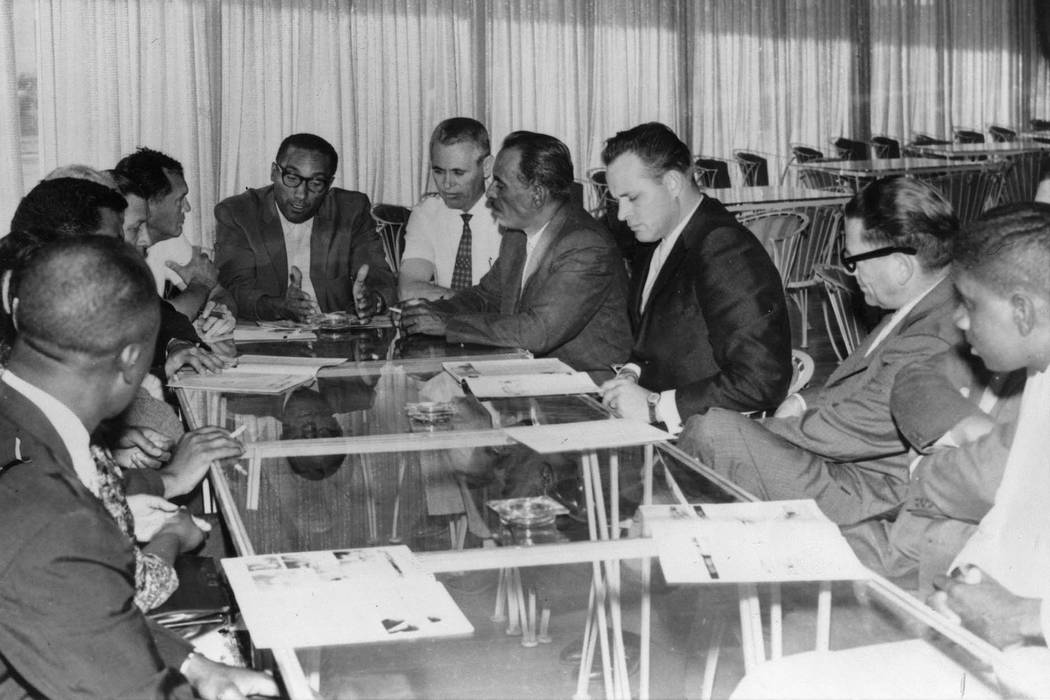 Dr. James McMilan, center, president of NAACP Las Vegas, meets with Las Vegas officials and bla ...