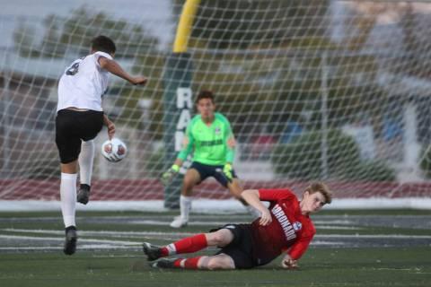 Las Vegas' Sergio Aguayo (18) takes a shot against Coronado's Josue Ruiz during the Southern Ne ...