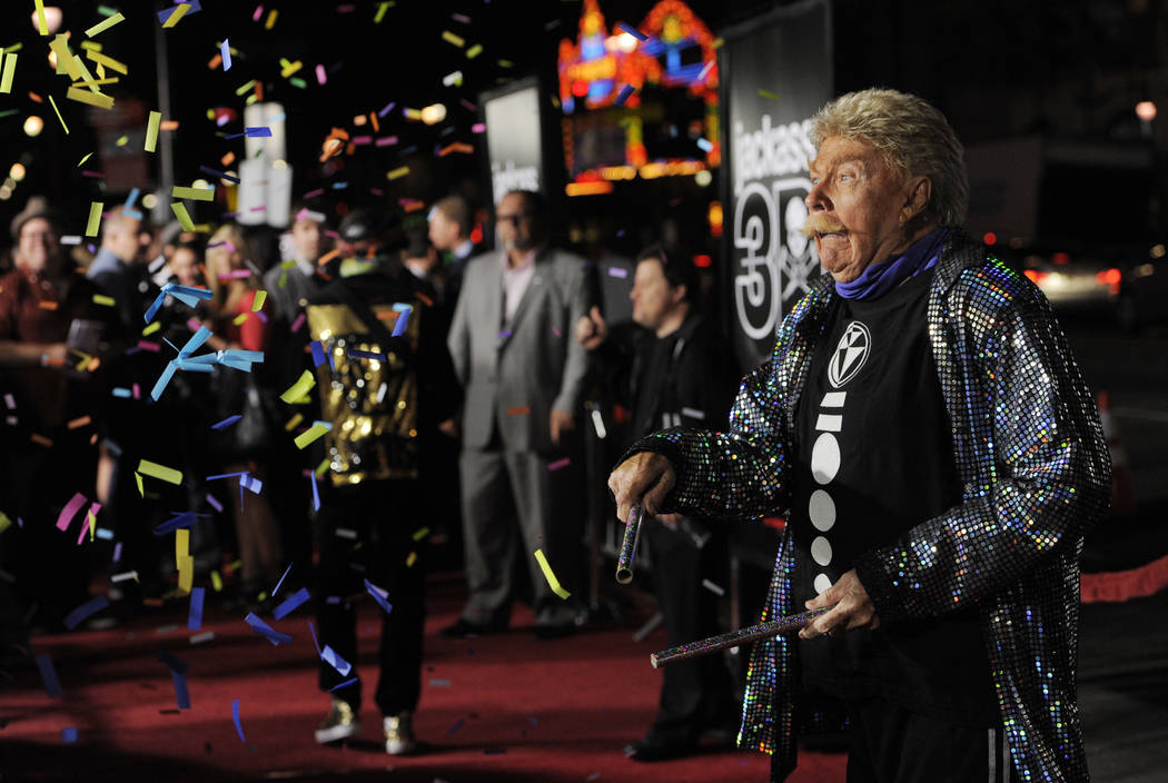 """Comedian Rip Taylor throws confetti on photographers at the premiere of the film """"Jackass ..."""
