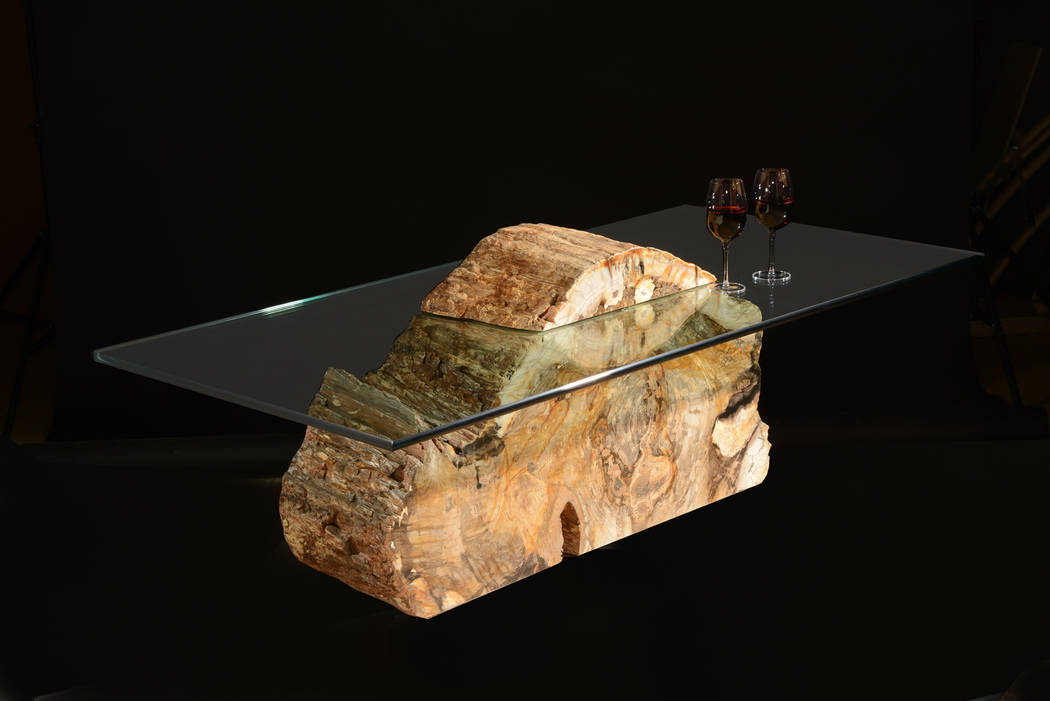 Artist Russell Zuhl creates furniture from petrified wood hundreds of millions of years old. Hi ...