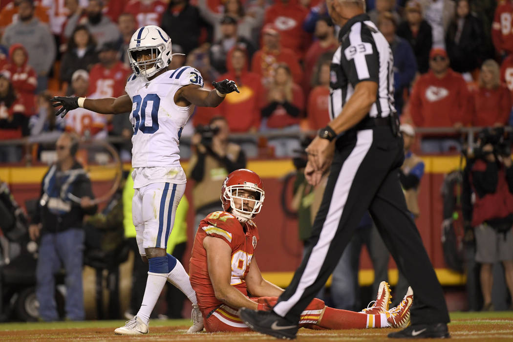 Indianapolis Colts safety George Odum (30) stands over Kansas City Chiefs tight end Travis Kelc ...