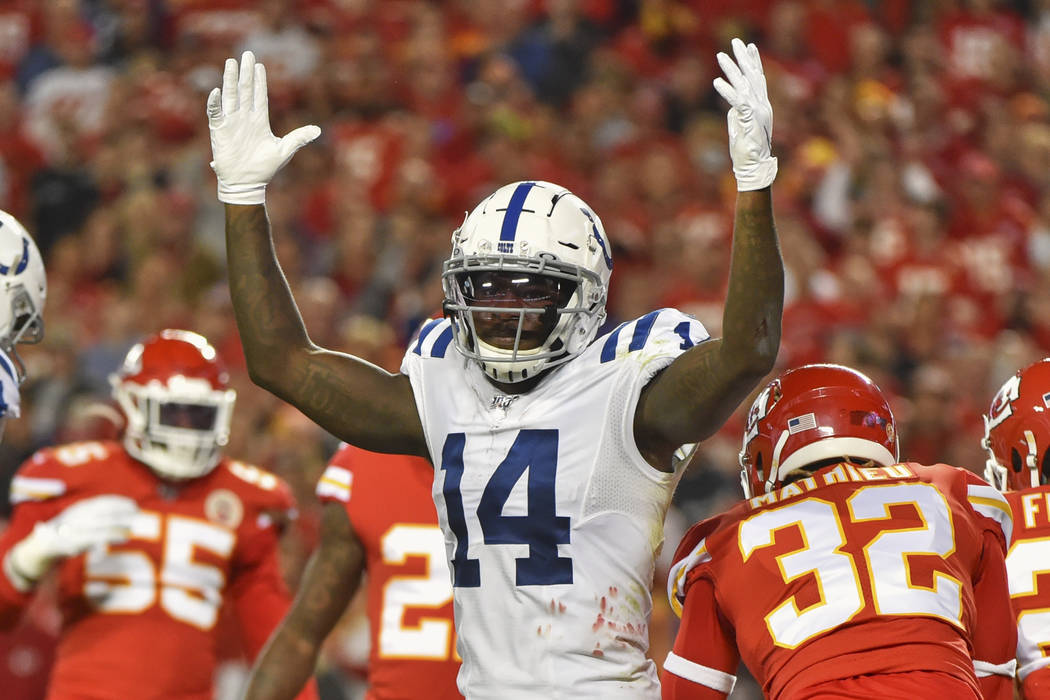 Indianapolis Colts wide receiver Zach Pascal (14) signals a touchdown during the first half of ...