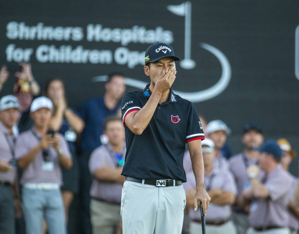 Kevin Na is shocked at a near miss to win while putting on the green at hole 18 during the fina ...