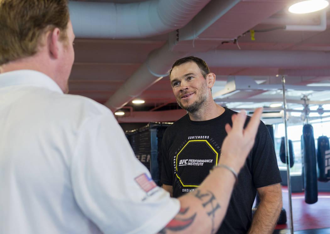 Former SEAL Team Six leader, Rob OÕNeill, left, and UFC Hall of Famer Forrest Griffin talk ...