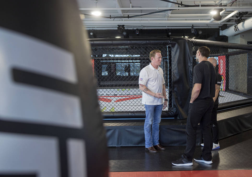 Former SEAL Team Six leader, Rob O'Neill, left, and UFC Hall of Famer Forrest Griffin meet at t ...