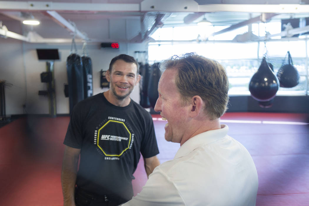 UFC Hall of Famer Forrest Griffin, left, and former SEAL Team Six leader Rob O'Neill meet at th ...