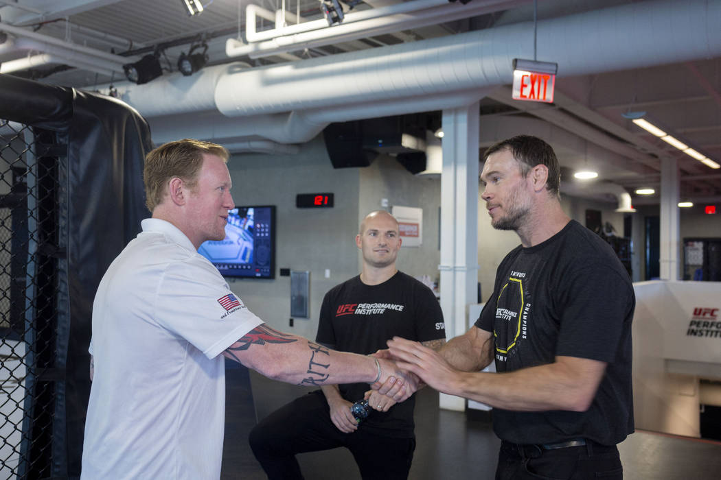 Former SEAL Team Six leader Rob O'Neill, left, Vice President of operations for the UFC Perform ...