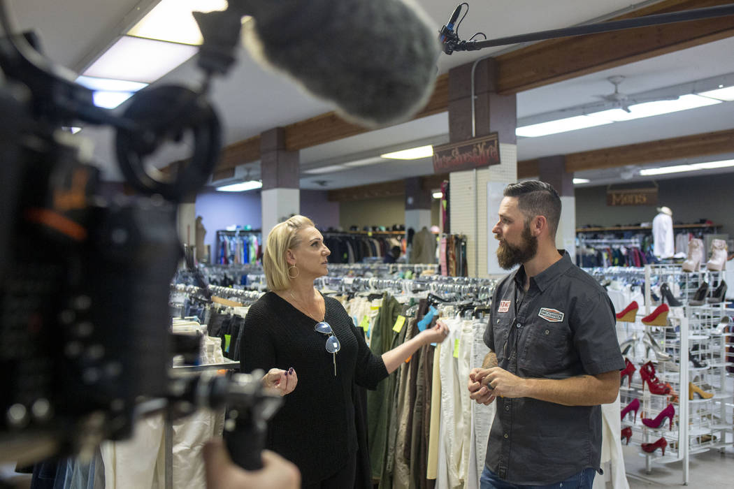 A camera team records Heather Engle, CEO of Las Vegas Rescue Mission, left, and pastor Brandan ...