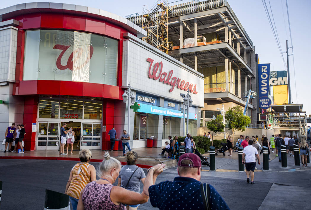 People walk by the Walgreens on the Las Vegas Strip on Tuesday, Sept. 10, 2019, in Las Vegas. ( ...