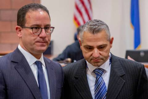 Defense attorney Richard Schonfeld, left, walks with Michel Rantissi Jr., 46, a physical therap ...