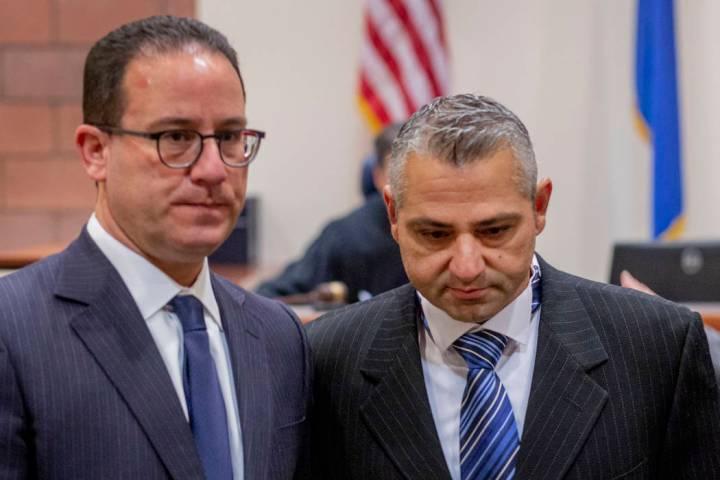 Defense attorney Richard Schonfeld, left, walks with Michel Rantissi Jr., 46, a physical therap ...