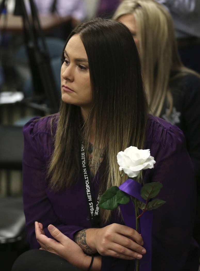 Shema Dannatt, victim advocate for the Rape Crisis Center, participate during a domestic viole ...