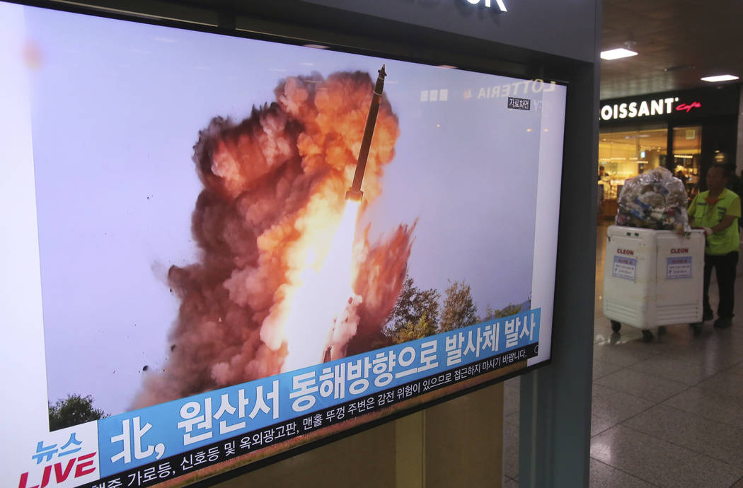A TV screen shows a file image of a North Korea's missile launch during a news program at the S ...