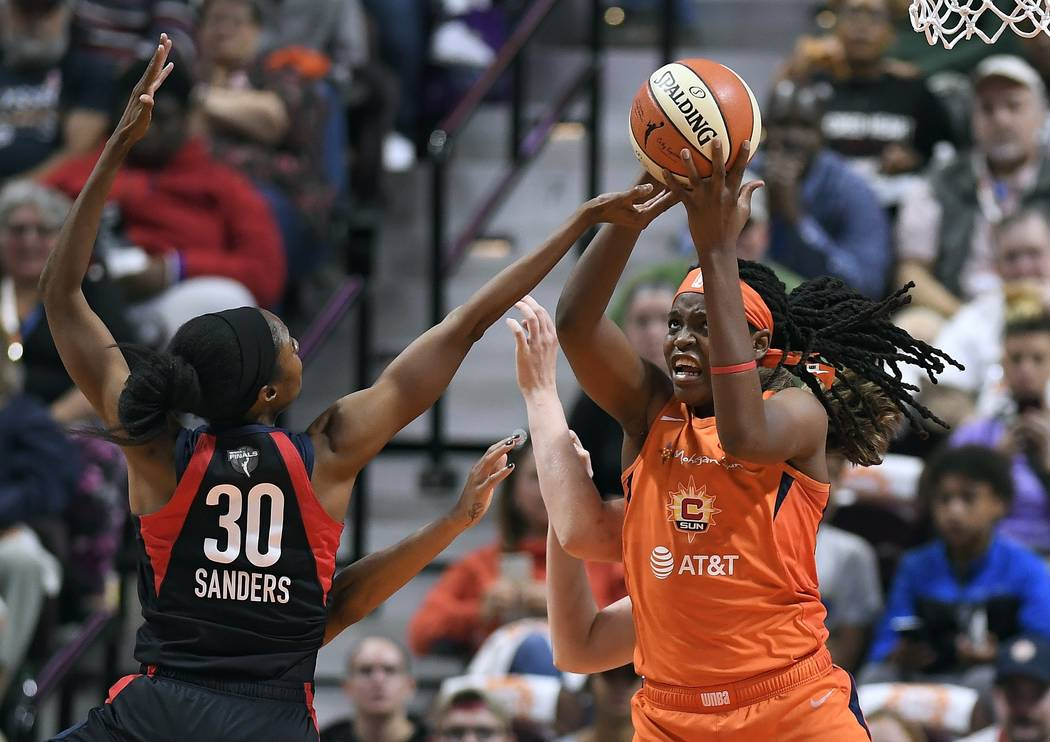 Connecticut Sun's Jonquel Jones, right, grabs a rebound in front of Washington Mystics' LaToya ...
