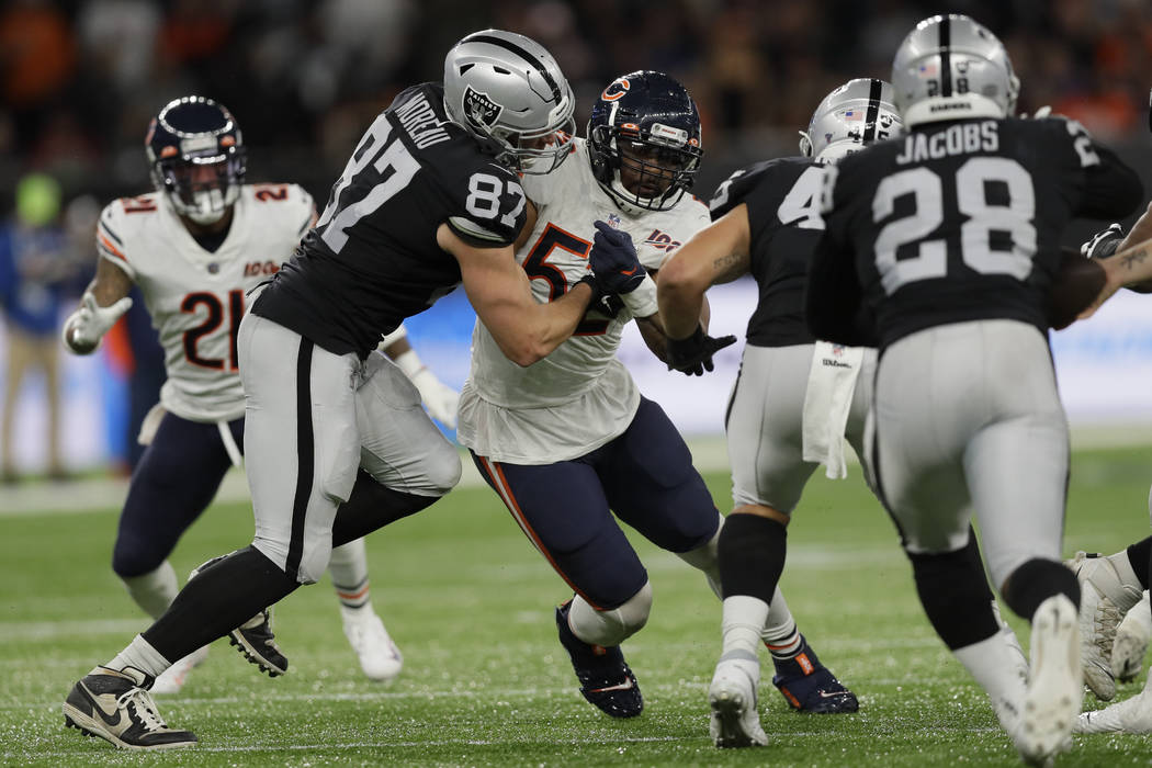 Chicago Bears outside linebacker Khalil Mack (52) is blocked by Oakland Raiders tight end Foste ...