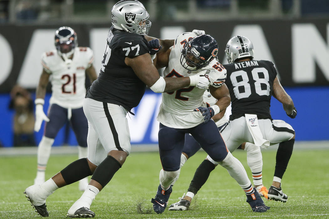 Chicago Bears outside linebacker Khalil Mack (52) is blocked by Oakland Raiders offensive tackl ...