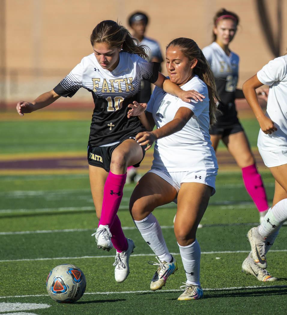 Faith Lutheran's Ari Gronauer (10, left) passes the ball away from Arbor View's Emma Oliva (17) ...