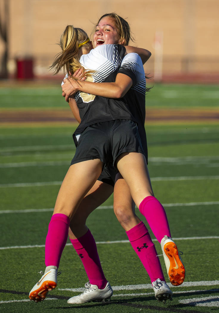 Faith Lutheran's Serene Gronauer (15, facing) hugs teammate Mackenzie Folk (8) after scoring on ...