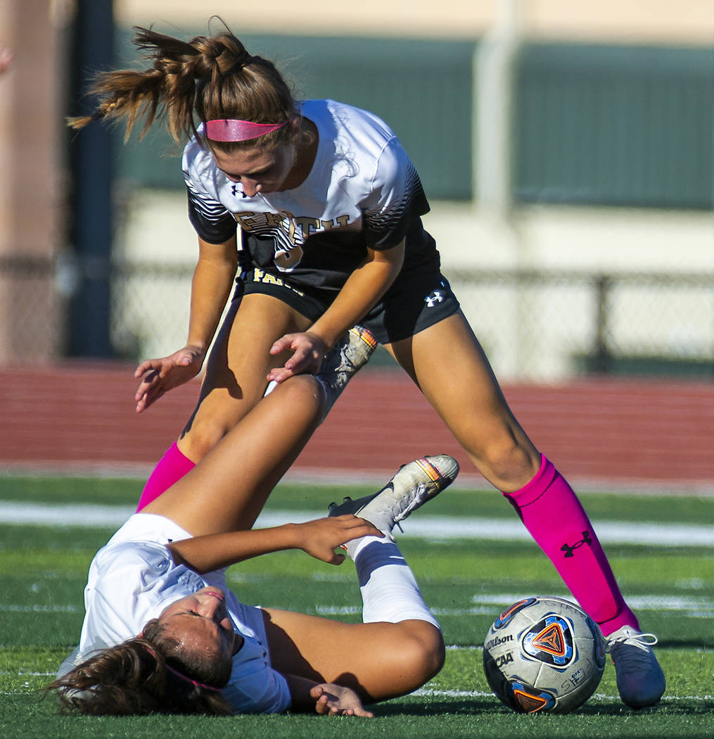 Faith Lutheran's Camille Longabardi (6, above) collides with Arbor View's Elisa Corvalan (10, ...