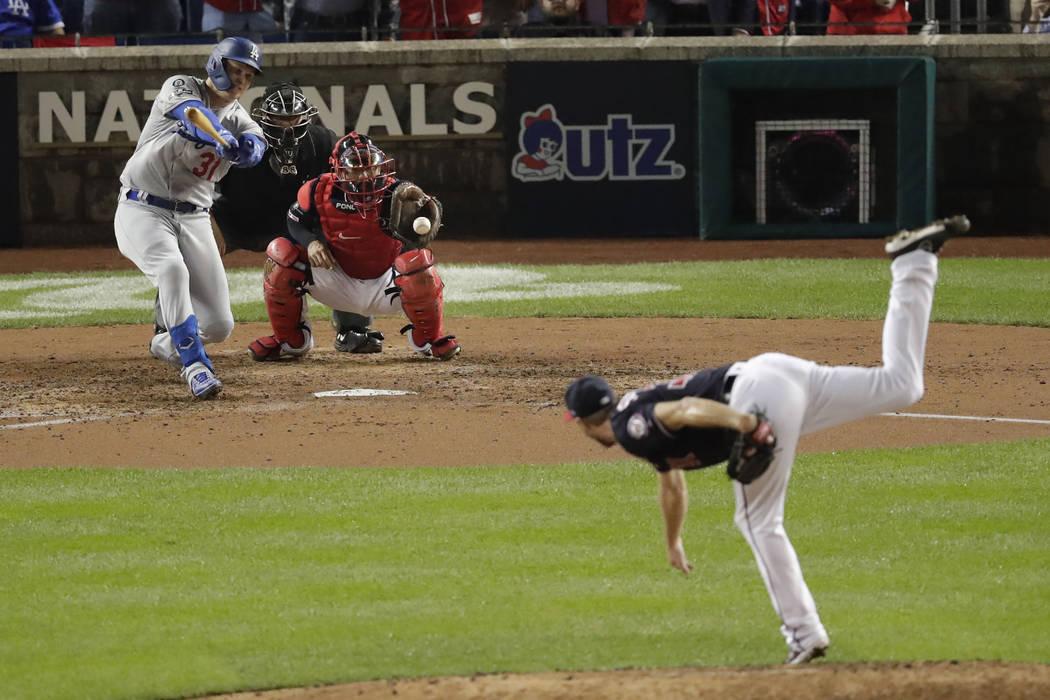 Los Angeles Dodgers' Joc Pederson, back left, strikes out swinging against Washington Nationals ...